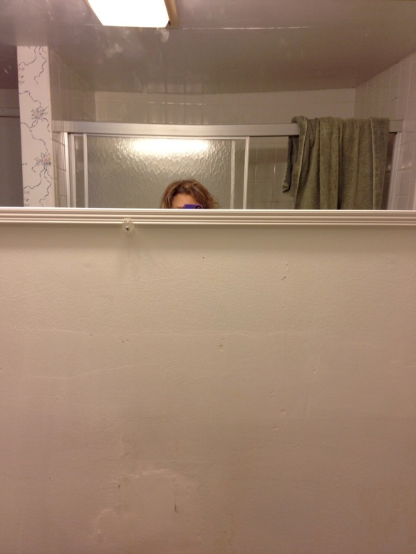 Here's what happened when Jeff hung a temporary mirror in our bathroom.